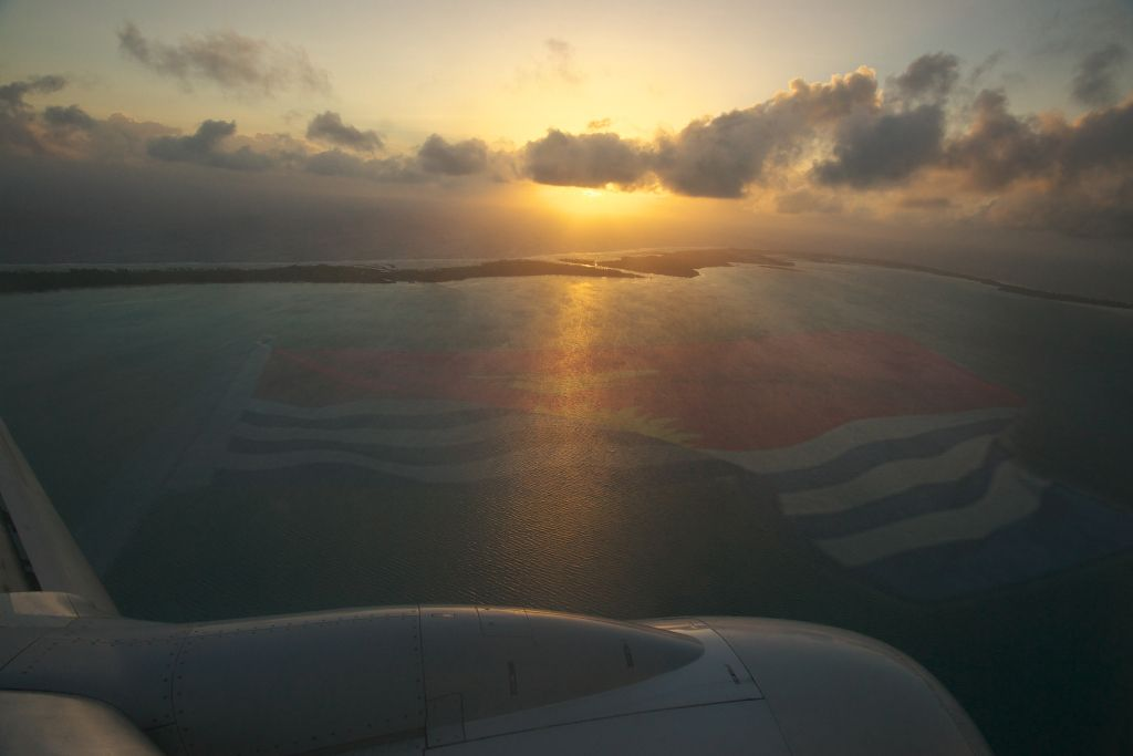 An aerial view of the main island of Tarawa and Kiribati flag