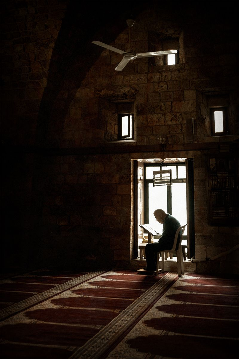 A reader by the window at Taynal Mosque s.jpg