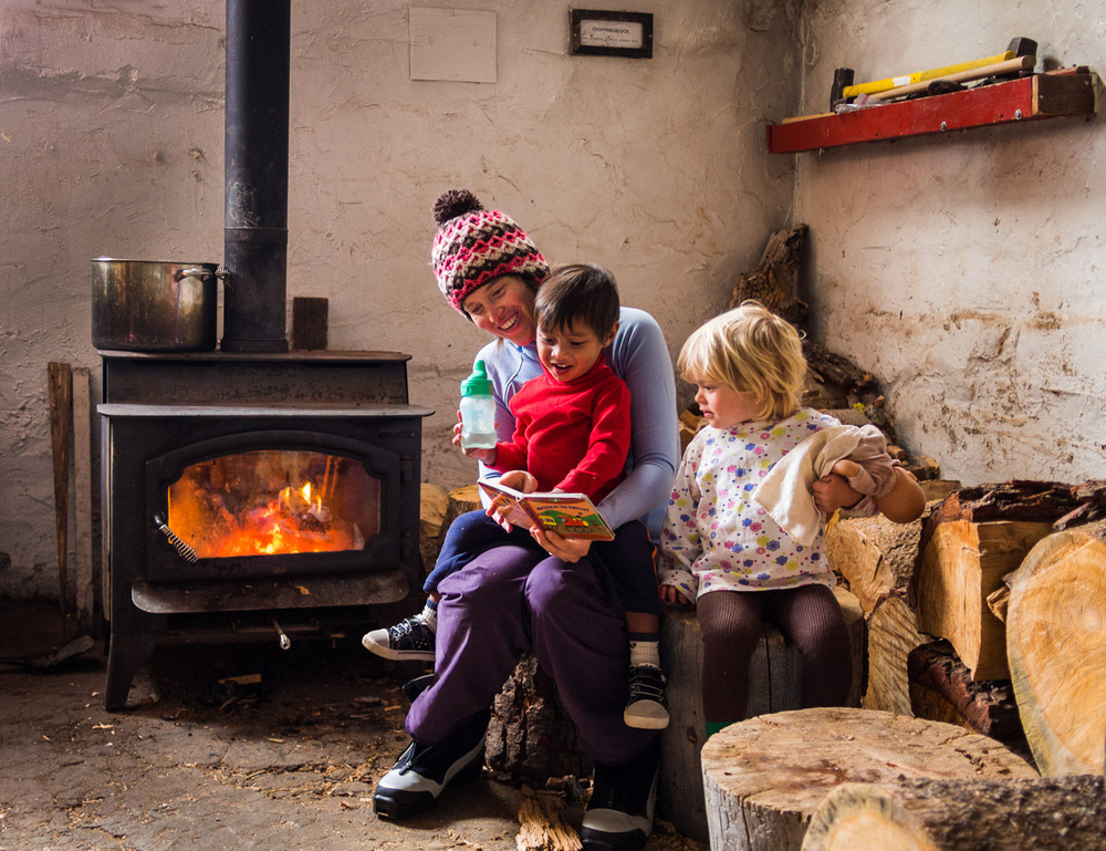 Mom Reading to Kids by Fireplace