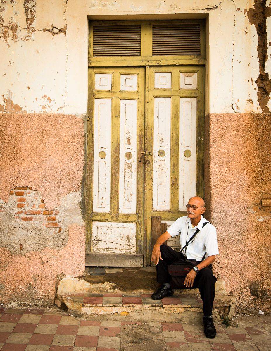 Local Man Poses in Front of Old Door