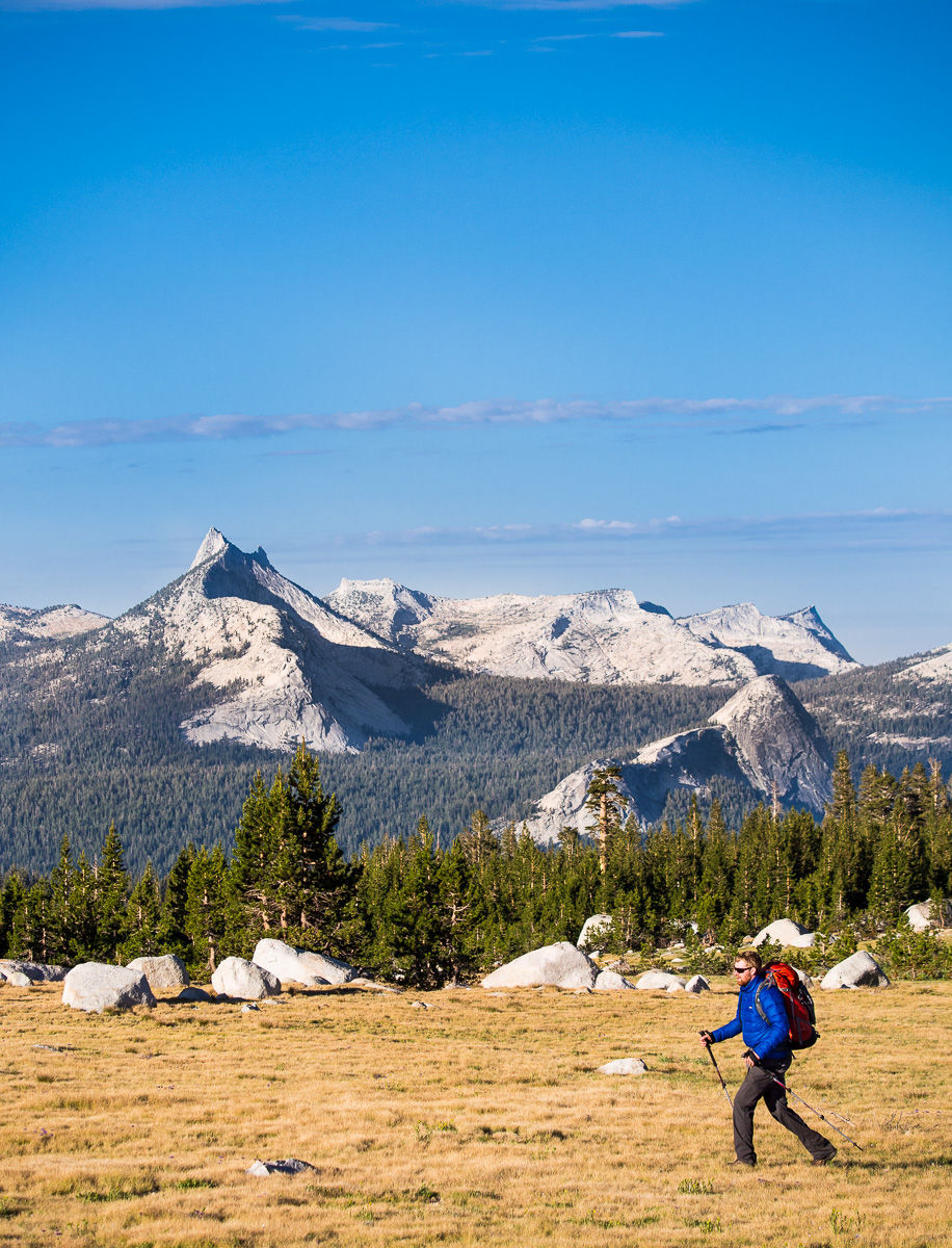 Hiker in Yosemite High Country with Cathedral Peak in Background