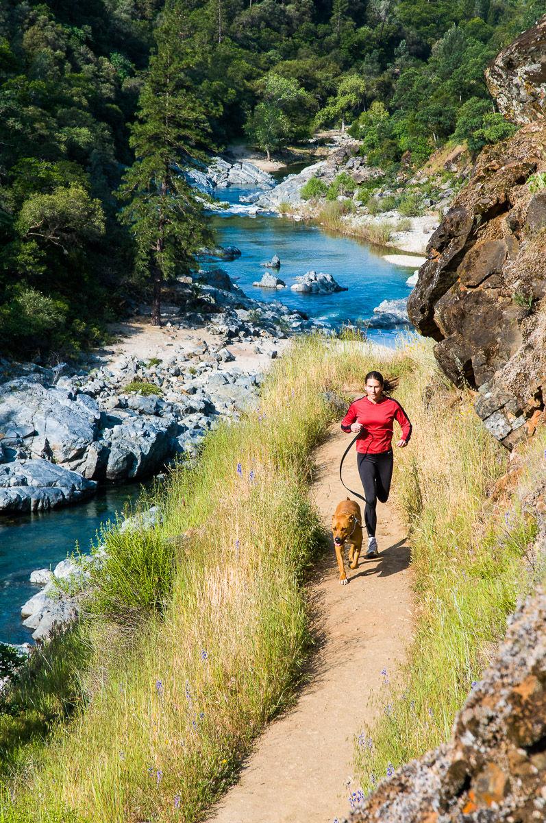 Woman Runs with her Dog along the Yuba River