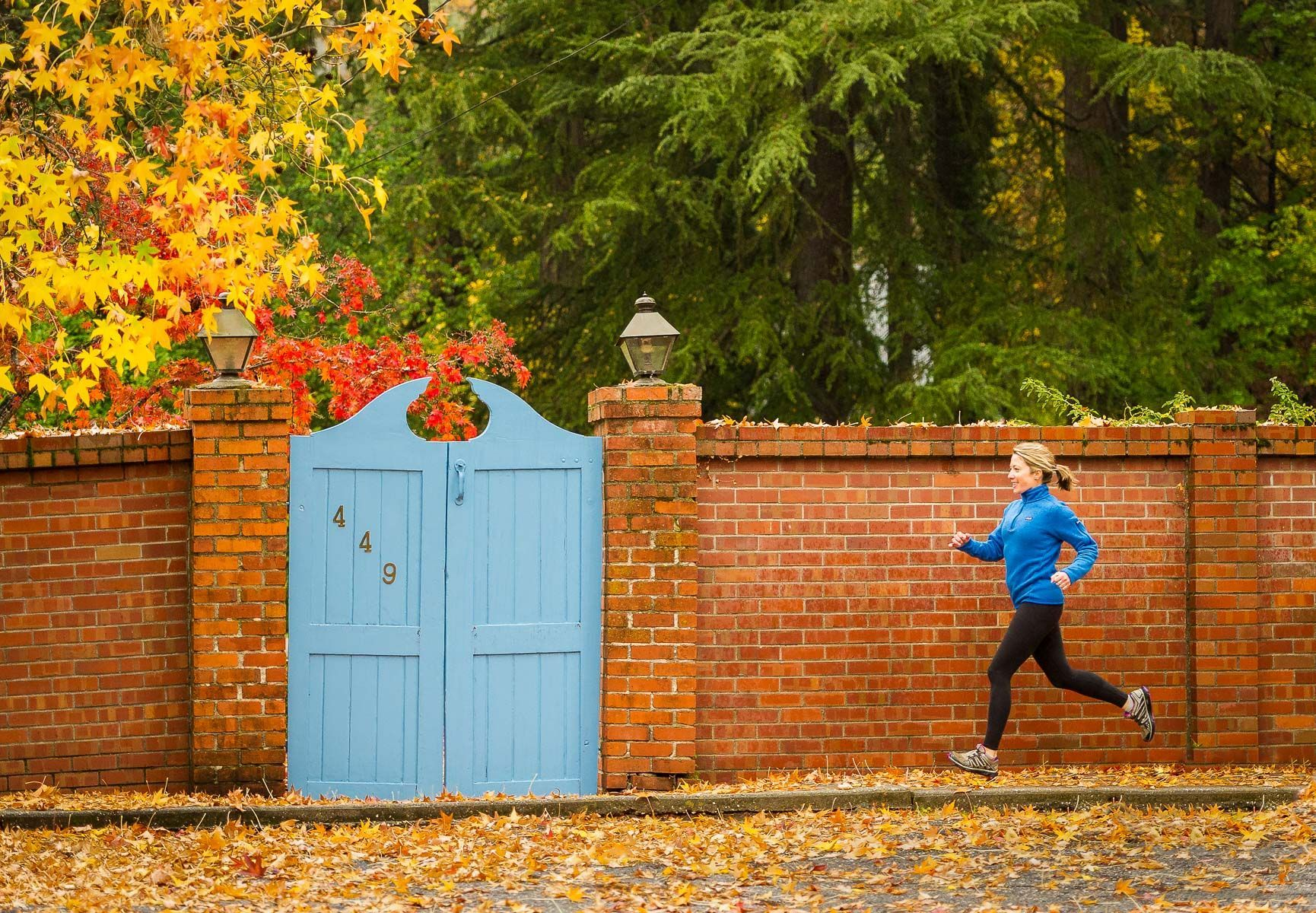 Young Woman Running in the Fall