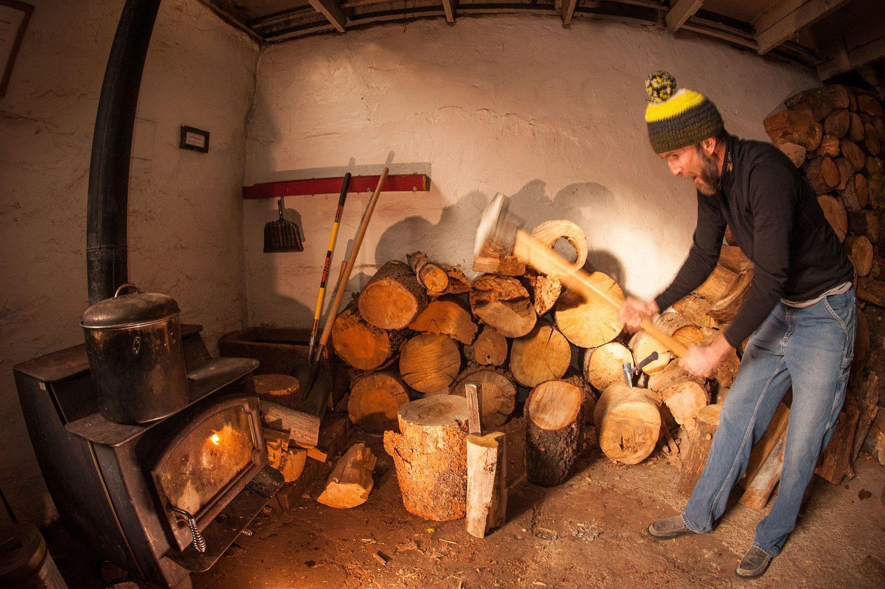 Man Splitting Firewood