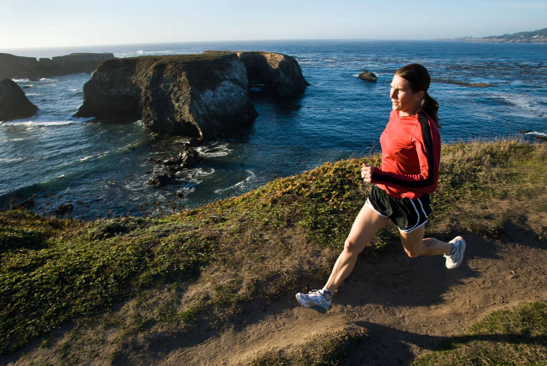 Woman Running on Coastal Trail