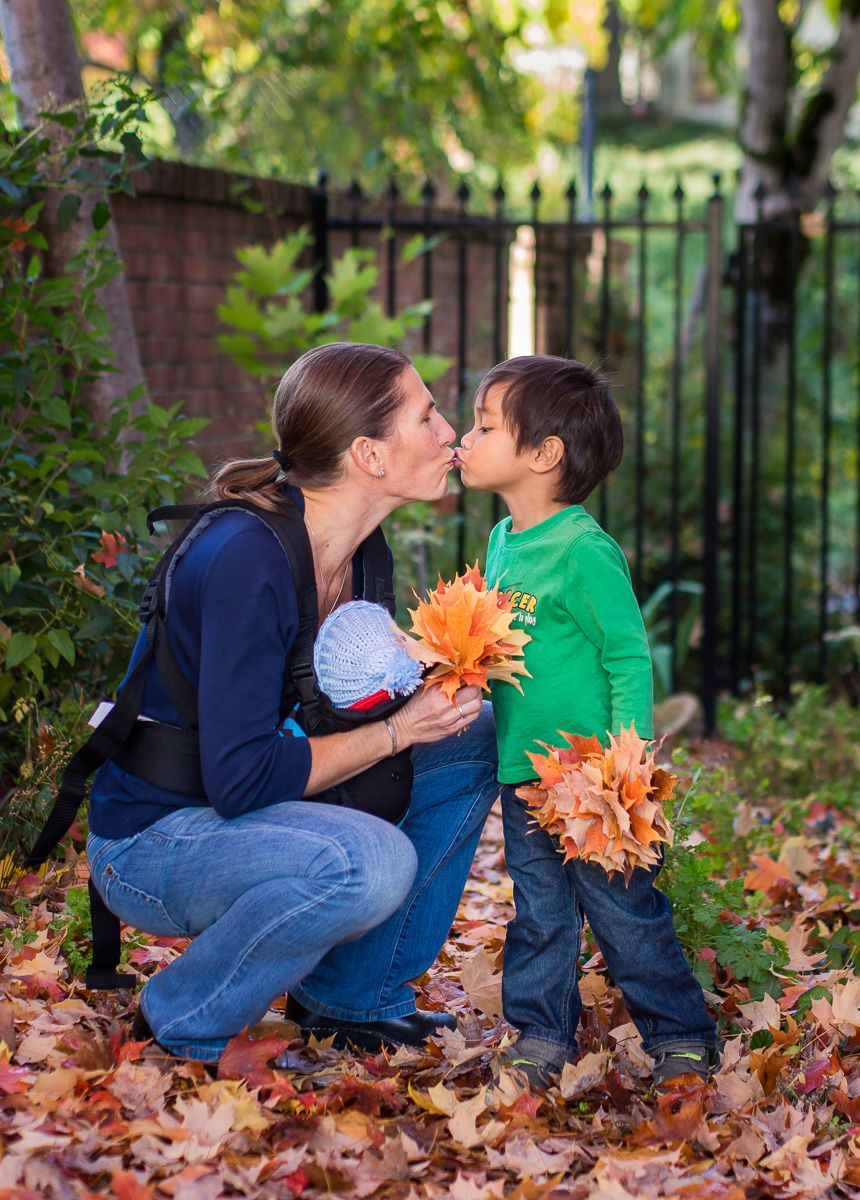 Young Boys and Mom Playing in Fall Leaves