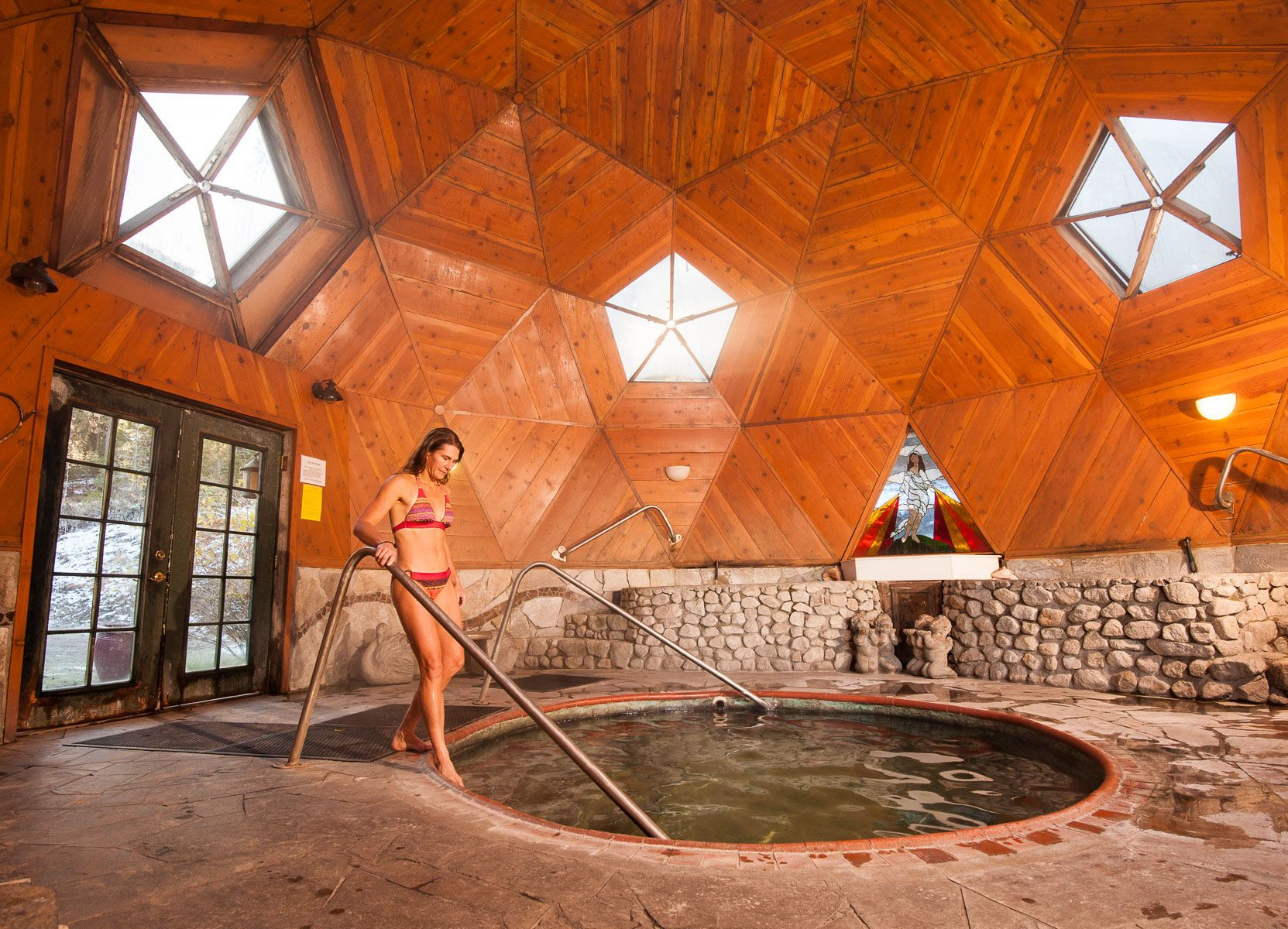 Woman Soaks in Geodesic Dome Hot Springs