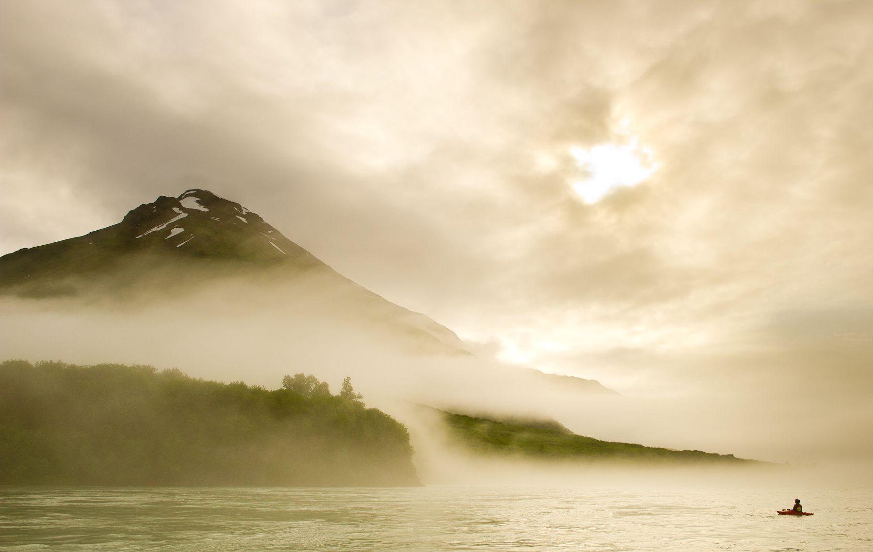 Kayaker engulfed in Marine Fog on the Alsek River