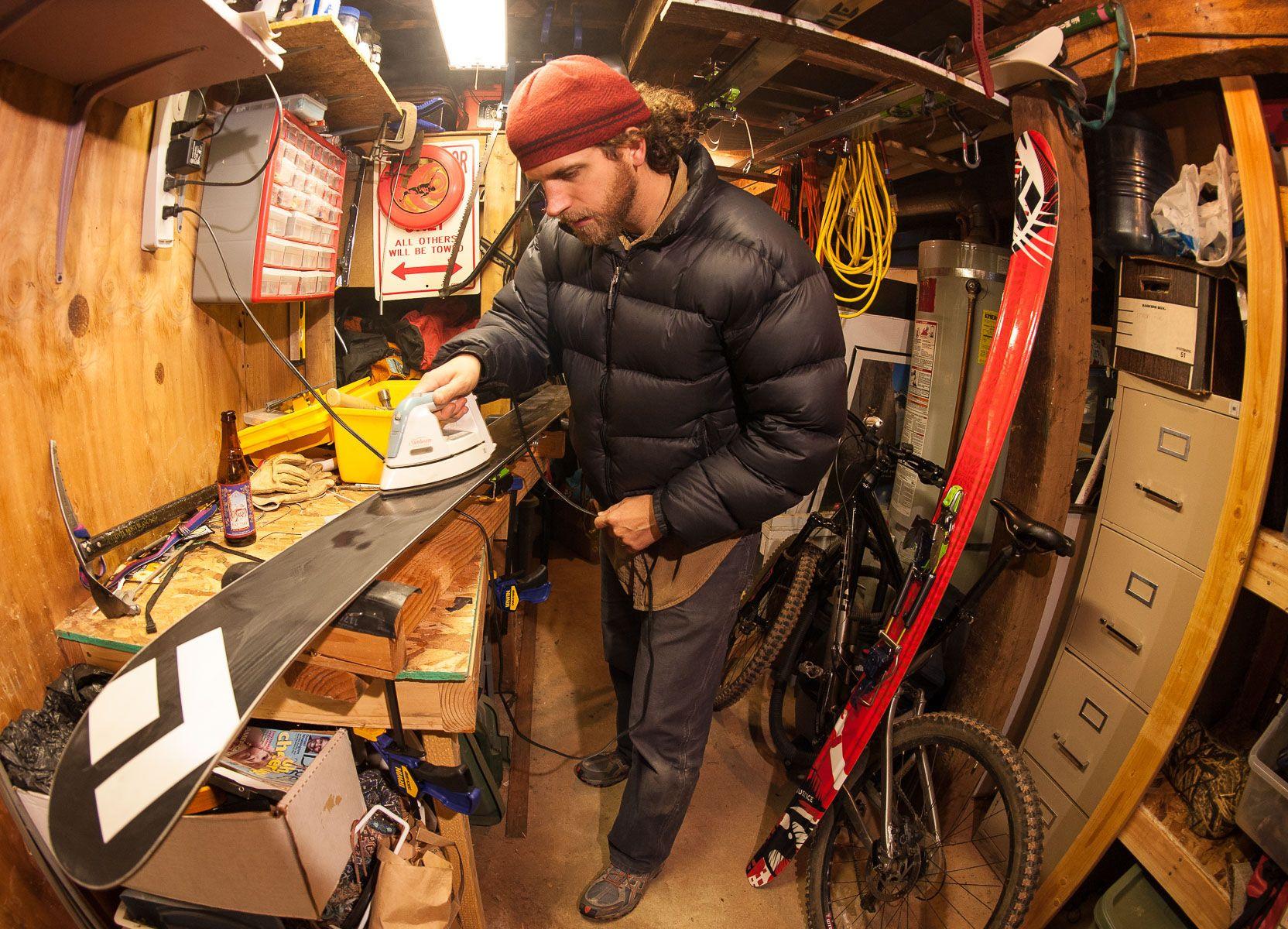 Man Waxing Skis
