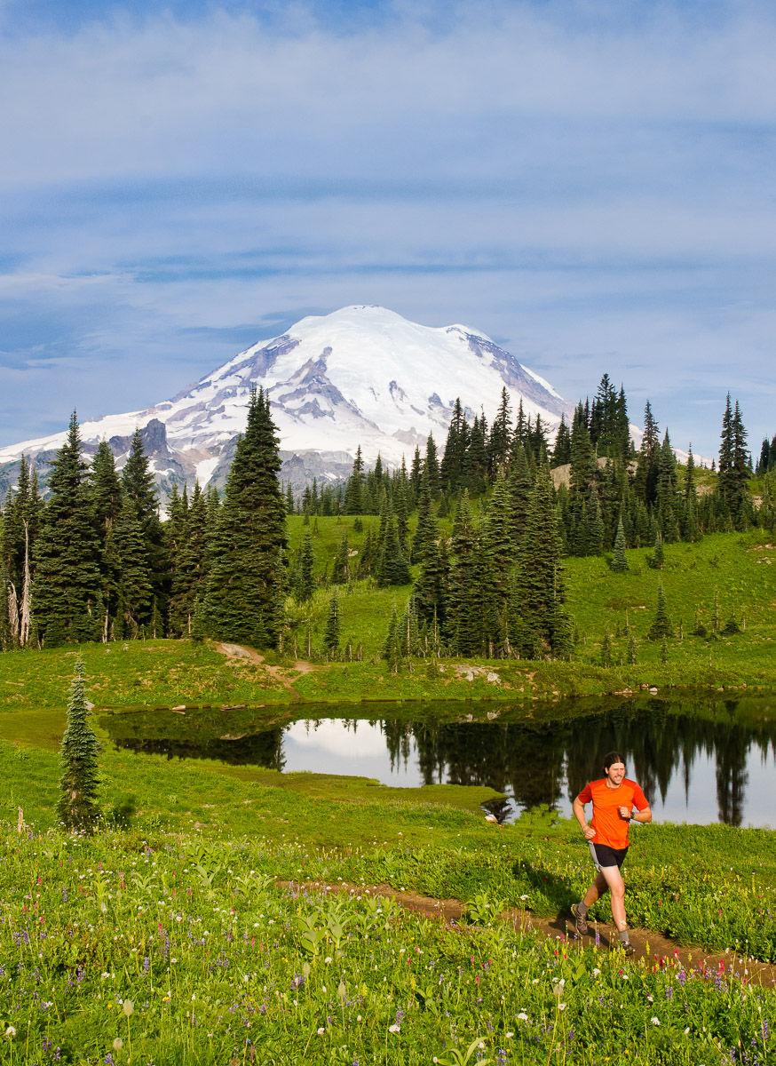 Man Trail Running with Mount Rainier in Background