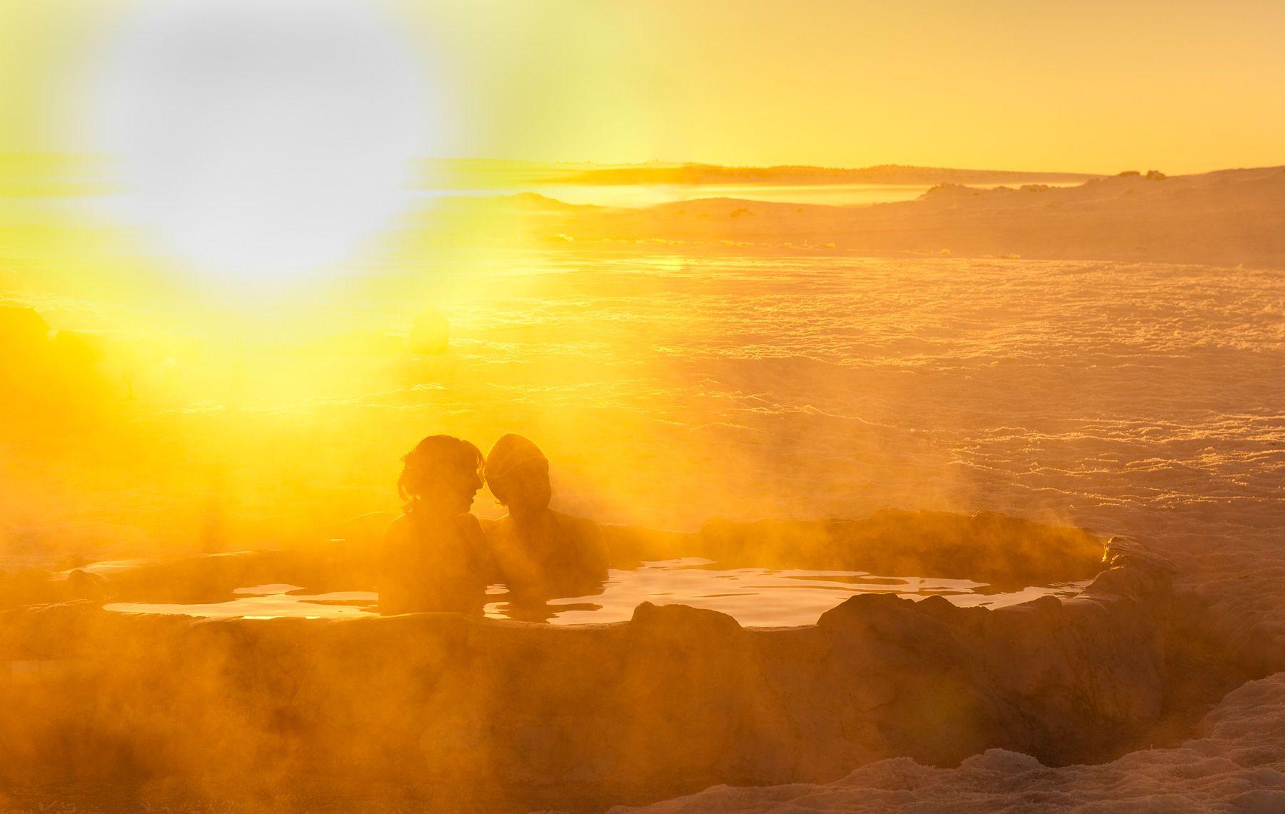 Couple Enjoys a Sunrise Soak in Hot Springs