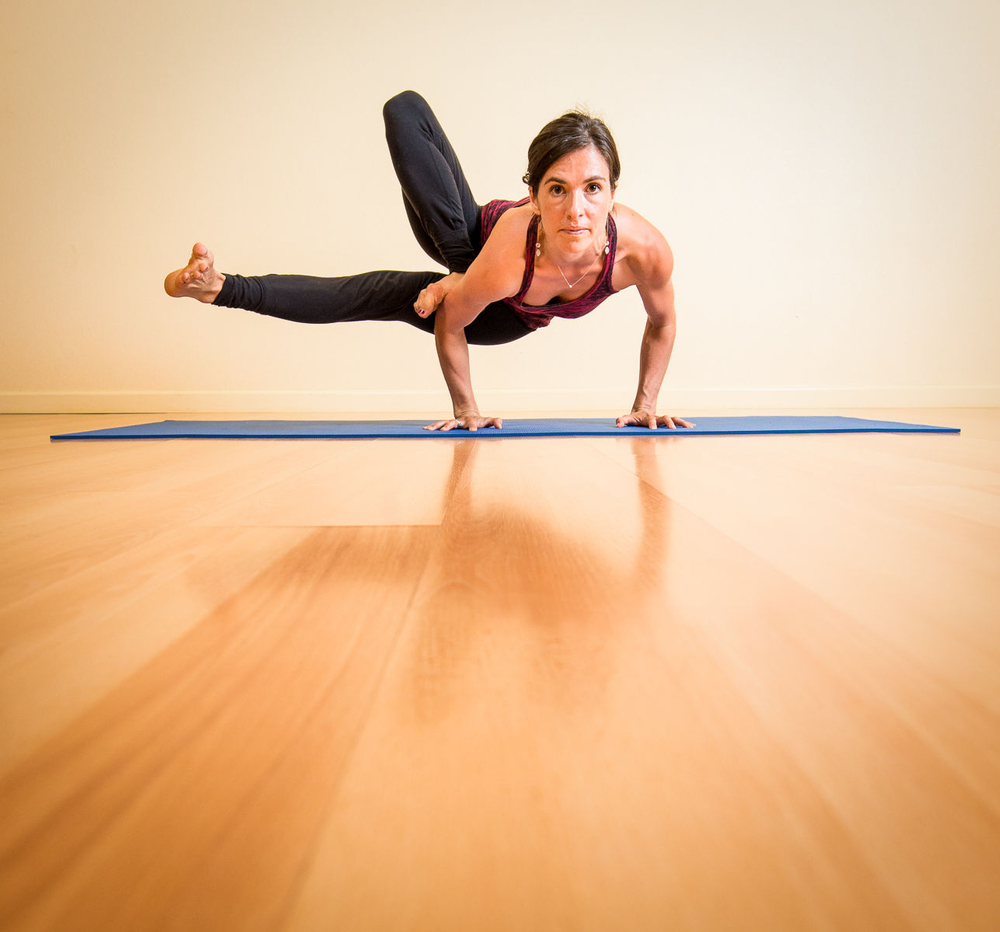 Young Woman Practicing Yoga in Studio