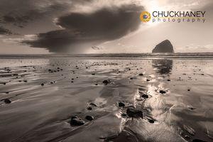 Haystack Rock at sunset at Cape Kiwanda in Pacific City, Oregon, USA
