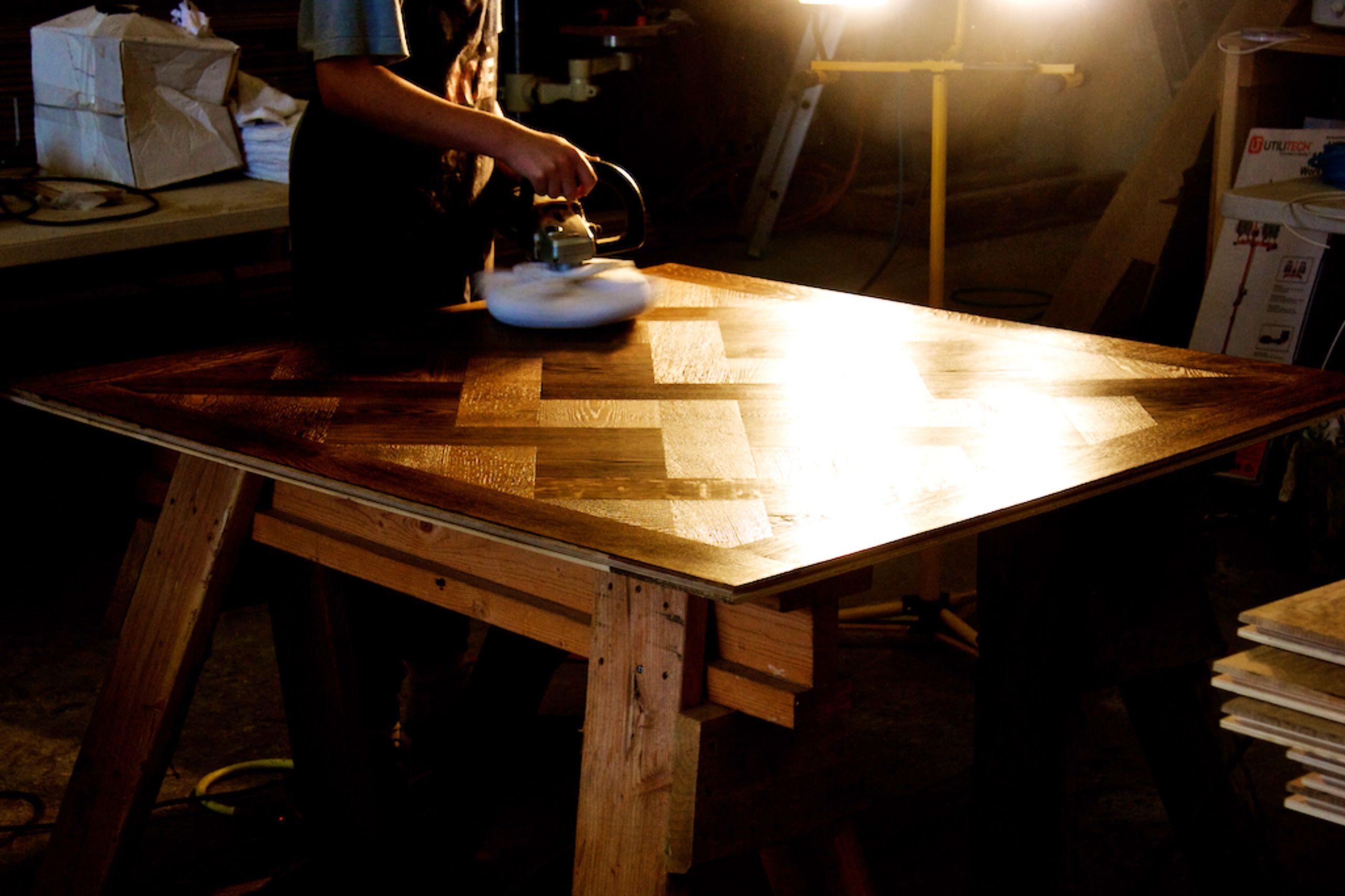 Hand buffing Versailles pattern floor