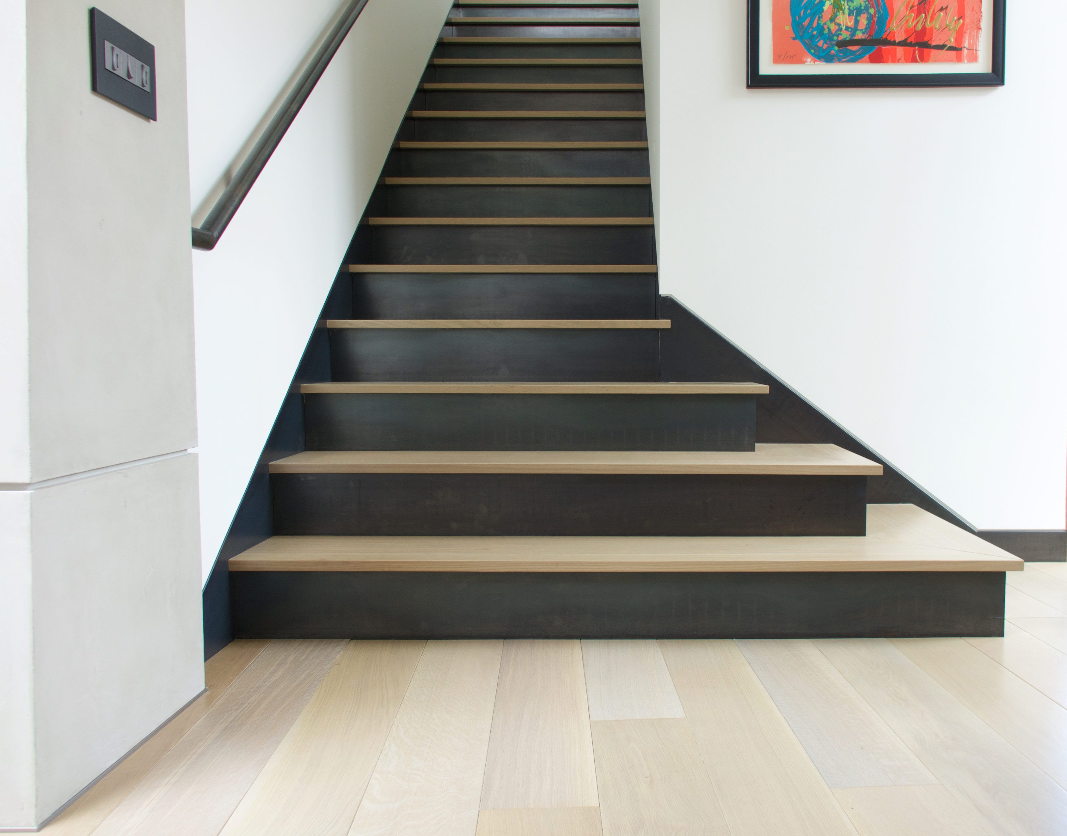 Reactive stained rift and quartered white oak stairs