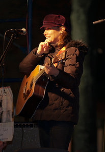 Musician performing outdoors at local concert