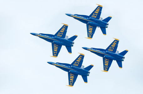 Blue Angels flying F-18 Superhornets in diamond formation