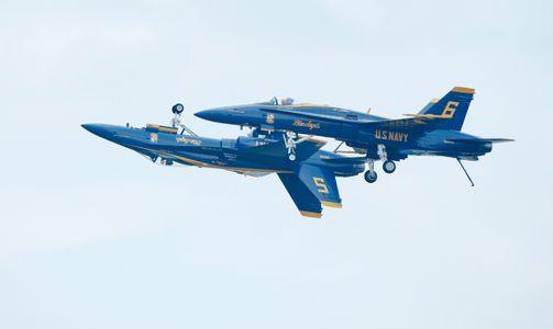 Blue Angels F-18 Superhornets doing over and under maneuver