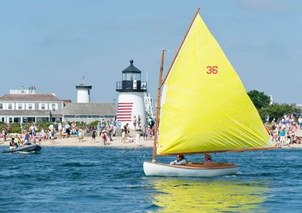 Beetle Cat off Brant Point Light at the Rainbow Parade before the Opera House Cup 2015 - Nantucket, MA