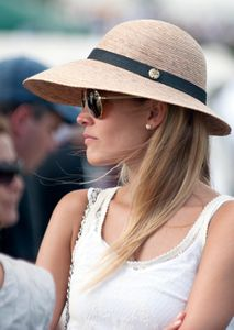 Candid  portrait of woman at polo match