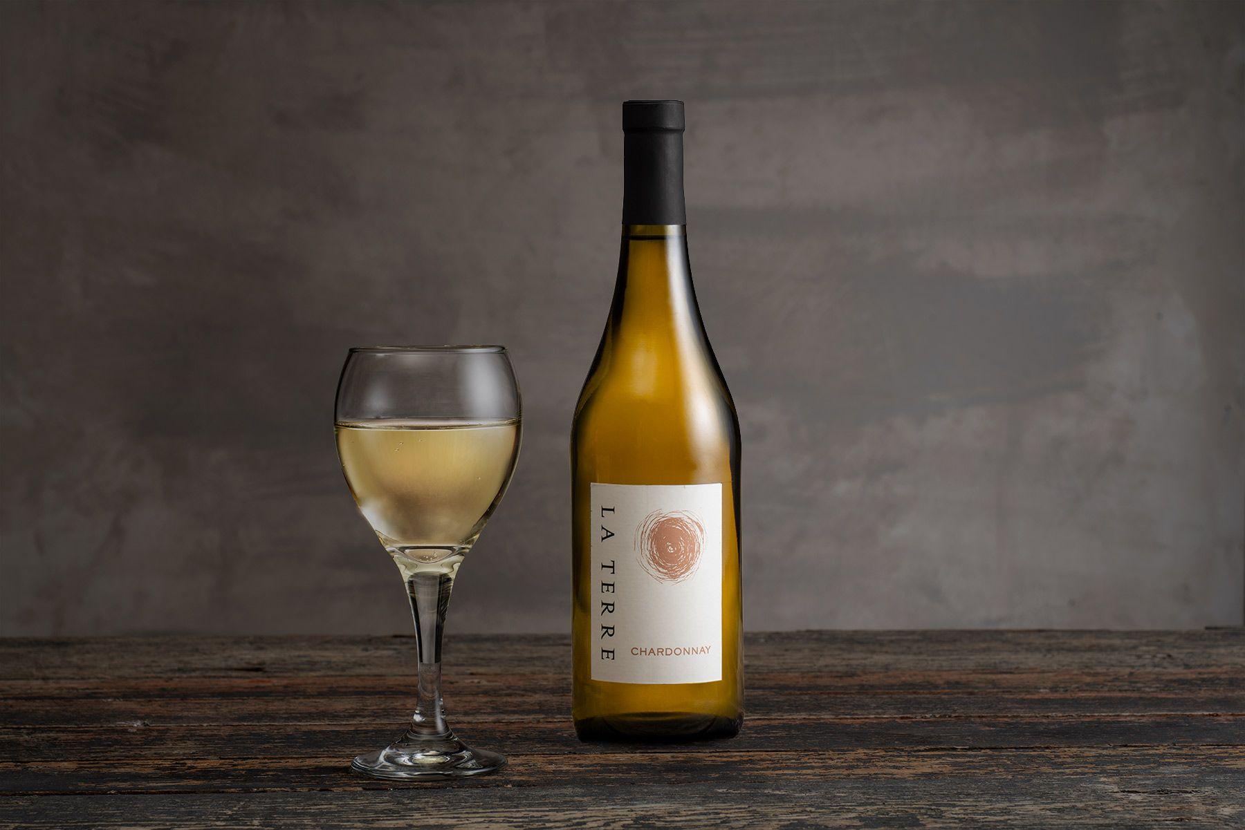 La-Terre-Chardonnay-w-glass-copy2.jpg