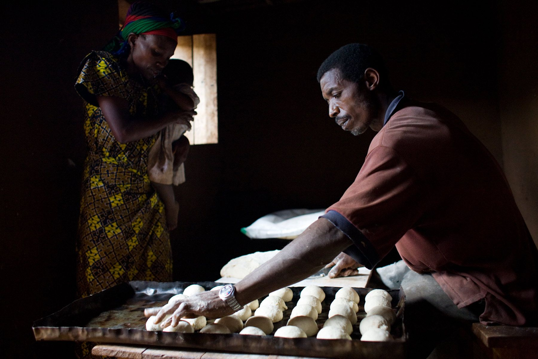 Turame Community Finance Burundi Africa loan recipient Viola with her baker and child