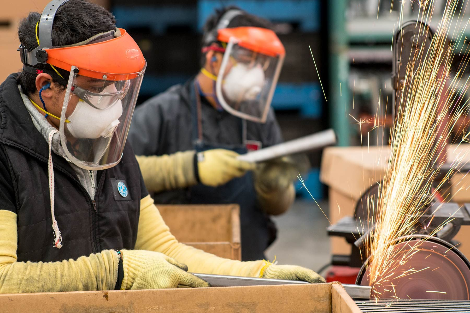 Shape-Queretaro-Mexico-workers-grind-burrs-from-tubing.jpg