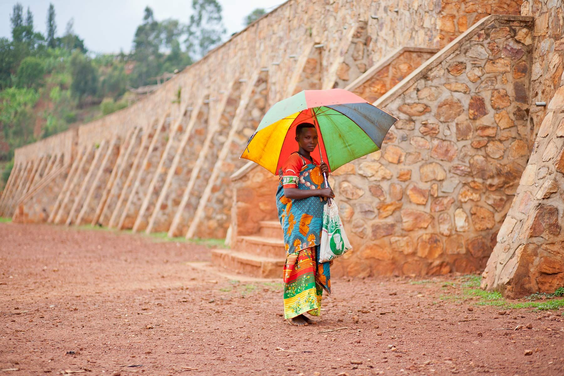 Woman-wilth-umbrella-Microfinance-loan-receipient.jpg