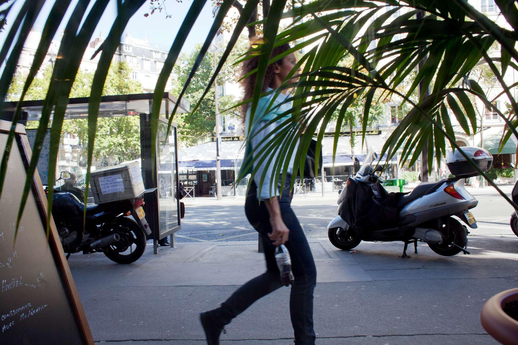 Paris-woman-walking-through-palm-leaves.jpg