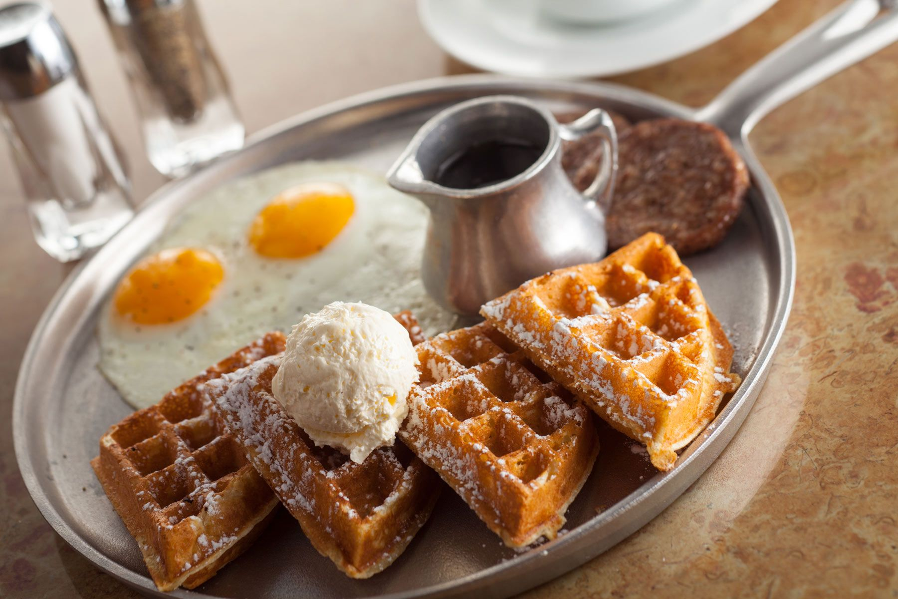 Eggs-over-easy-sausage-patty-waffles-and-honey-butter-syrup-Gun-Lake-Casino_380.jpg