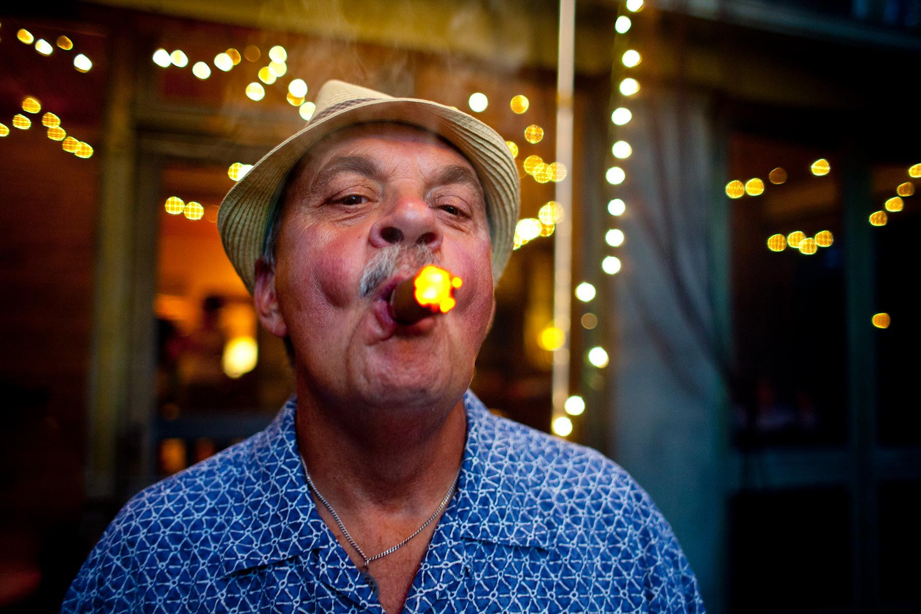"""Mike Zolik II, retired educator with cigar at party in Grand Haven, MI,   Mike and his wife Kathy moved from the Detroit area to Grand Haven for retirement.  Not only is Grand Haven in the running for """"best freshwater beach"""" with USA Today, Conde Nast Trav"""