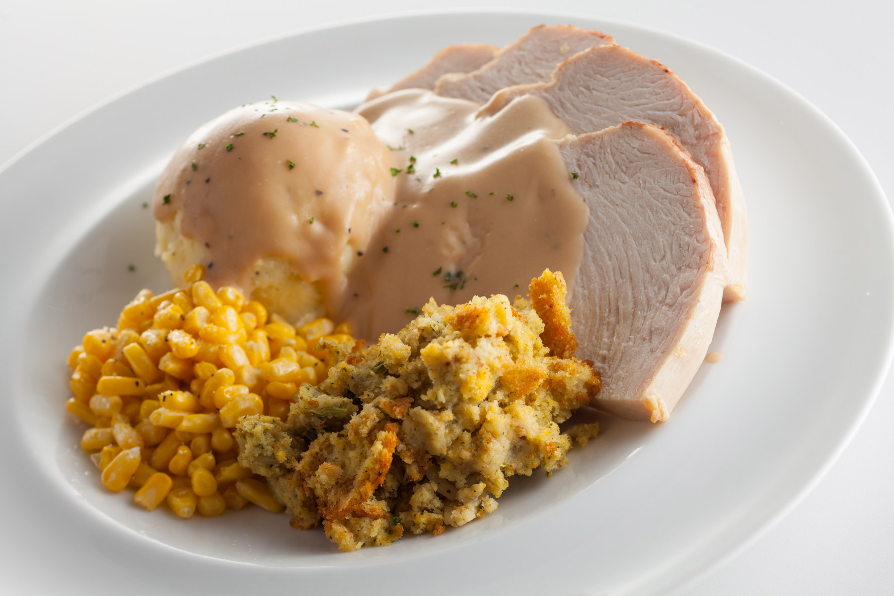 Sliced-Turkey-Breast-Mashed-Potatoes-and-Gravy-sweet-corn-and-stuffing-Gun-Lake-Casino_274.jpg