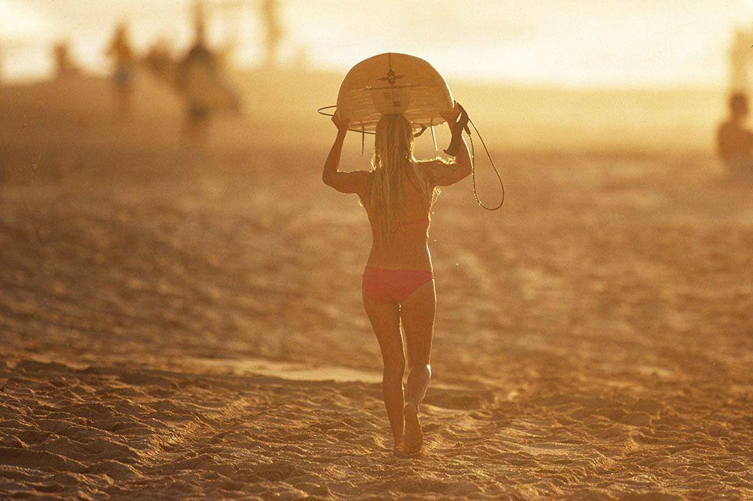 2 surfer girl pupukea oahu sunset by jeff divine .jpg