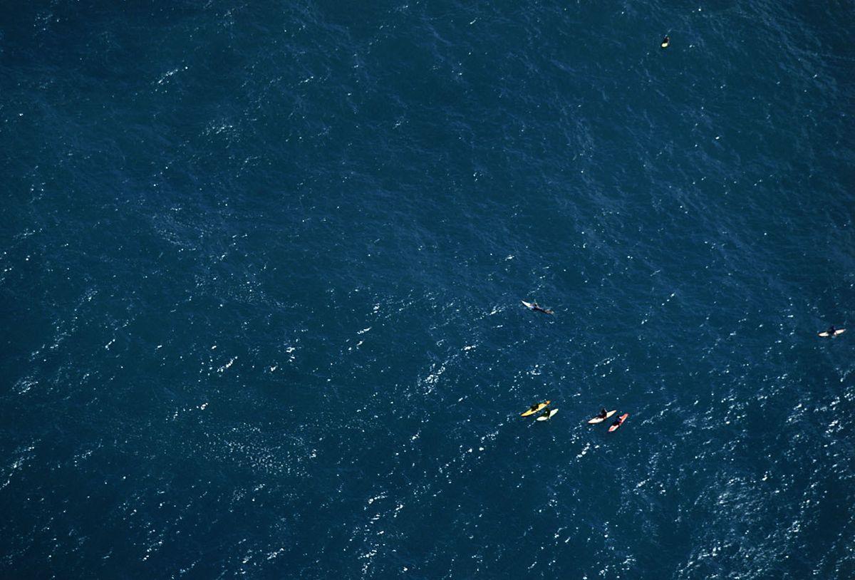 WAIMEA BAY , OAHU , SURFERS