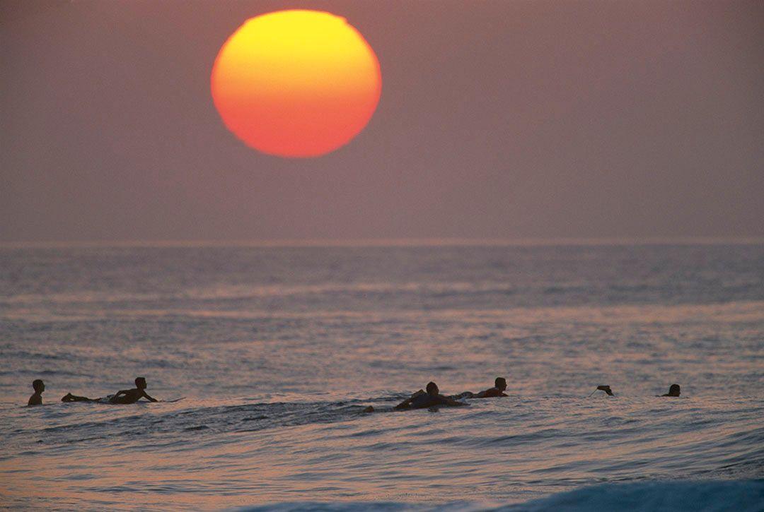 acorrected a bit tdrum pupukea sunset ball surfers jeff divine 7002462-003.jpg