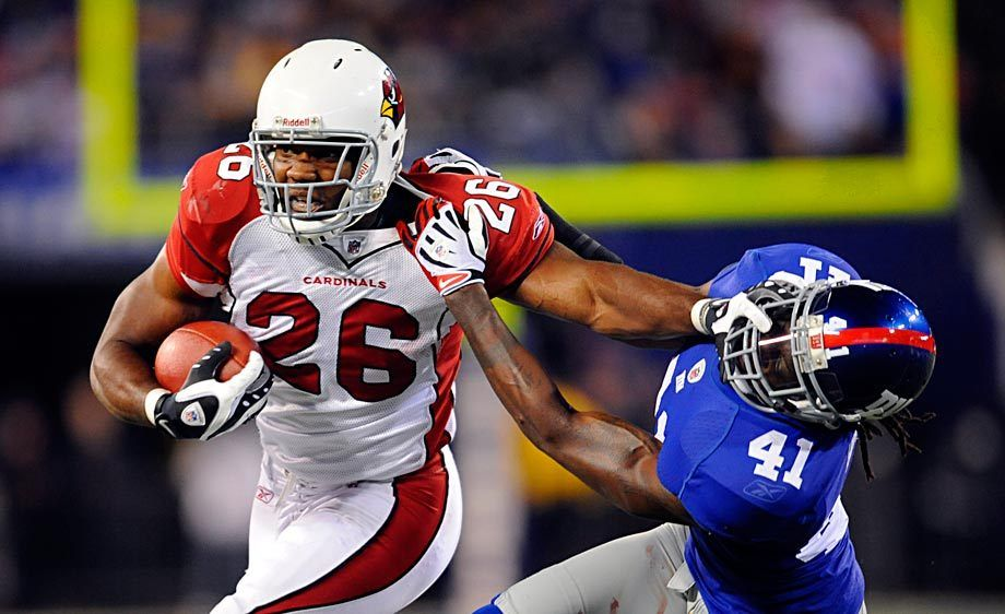 Arizona Cardinals running back Beanie Wells (26) stiff arms New York Giants safety C.C. Brown (41)
