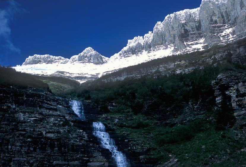 WATERFALL AT GARDEN WALLGLACIER NATIONAL PARK, MONTANAIMAGE # 12175