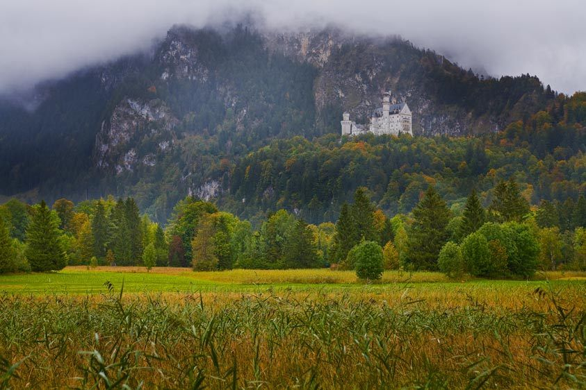 NEUSCHWANSTEIN CASTLE, FARM FIELDSCHWANGUA, BAVARIA, GERMANYIMAGE # 11633