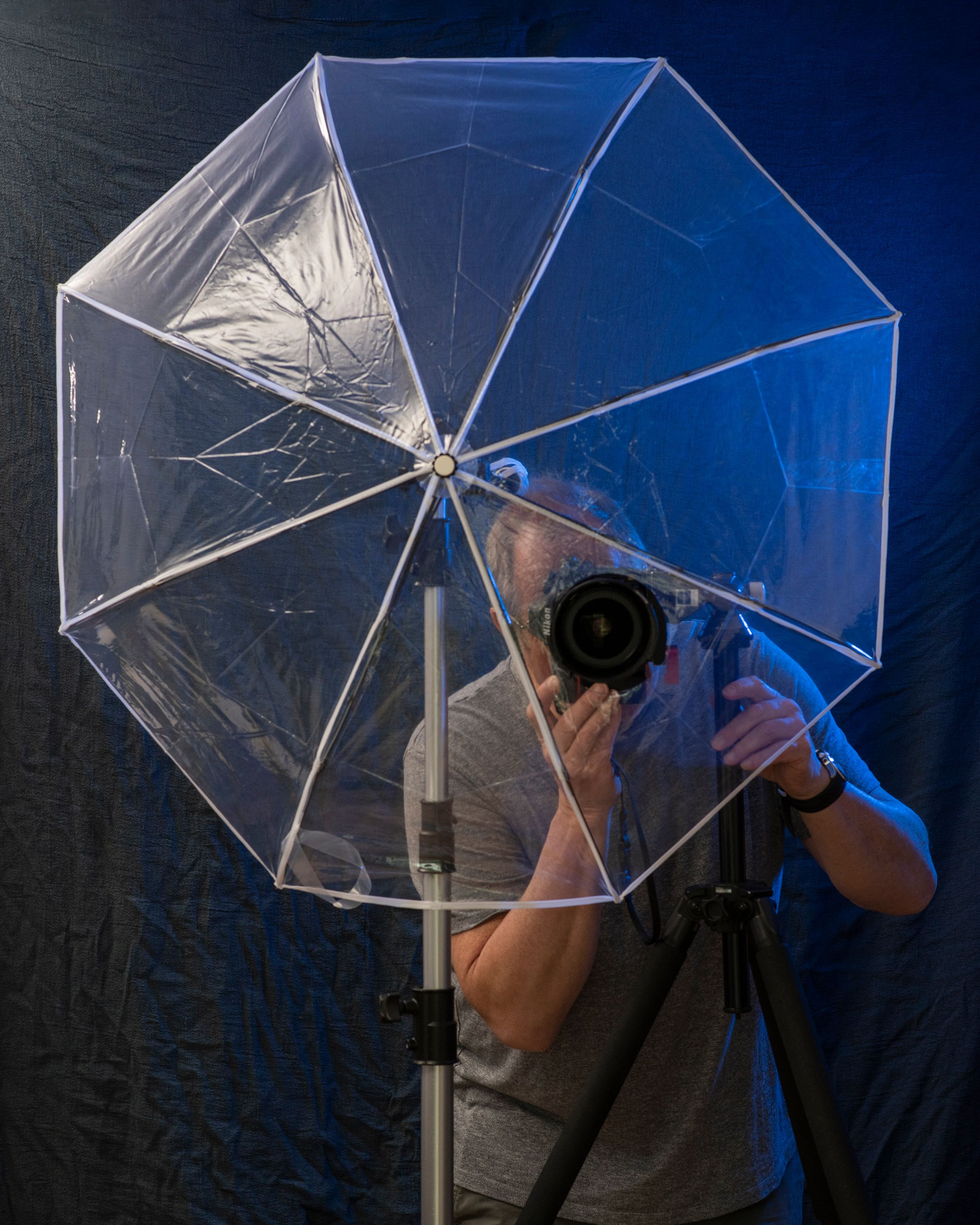 Transpaent Umbrella with photographer