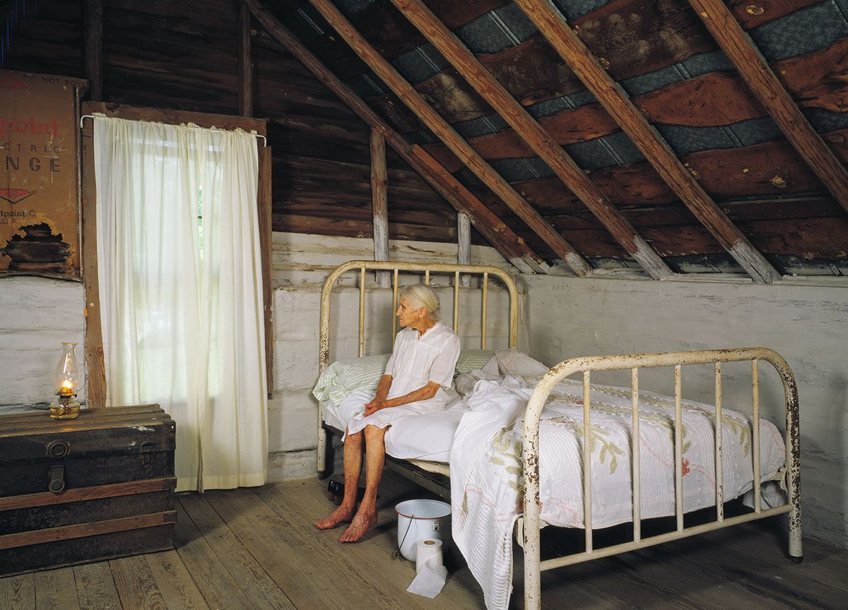 Kate Carter on her brass bed in Wentworth, North Carolina