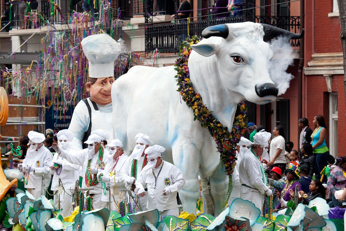 Boeuf Gras, a huge white bull surrounded by chefs, is a Mardi Gras float featured in the New Orleans Mardi Gras parade