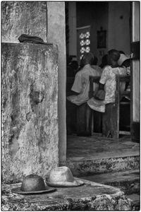 Hats by Church Door