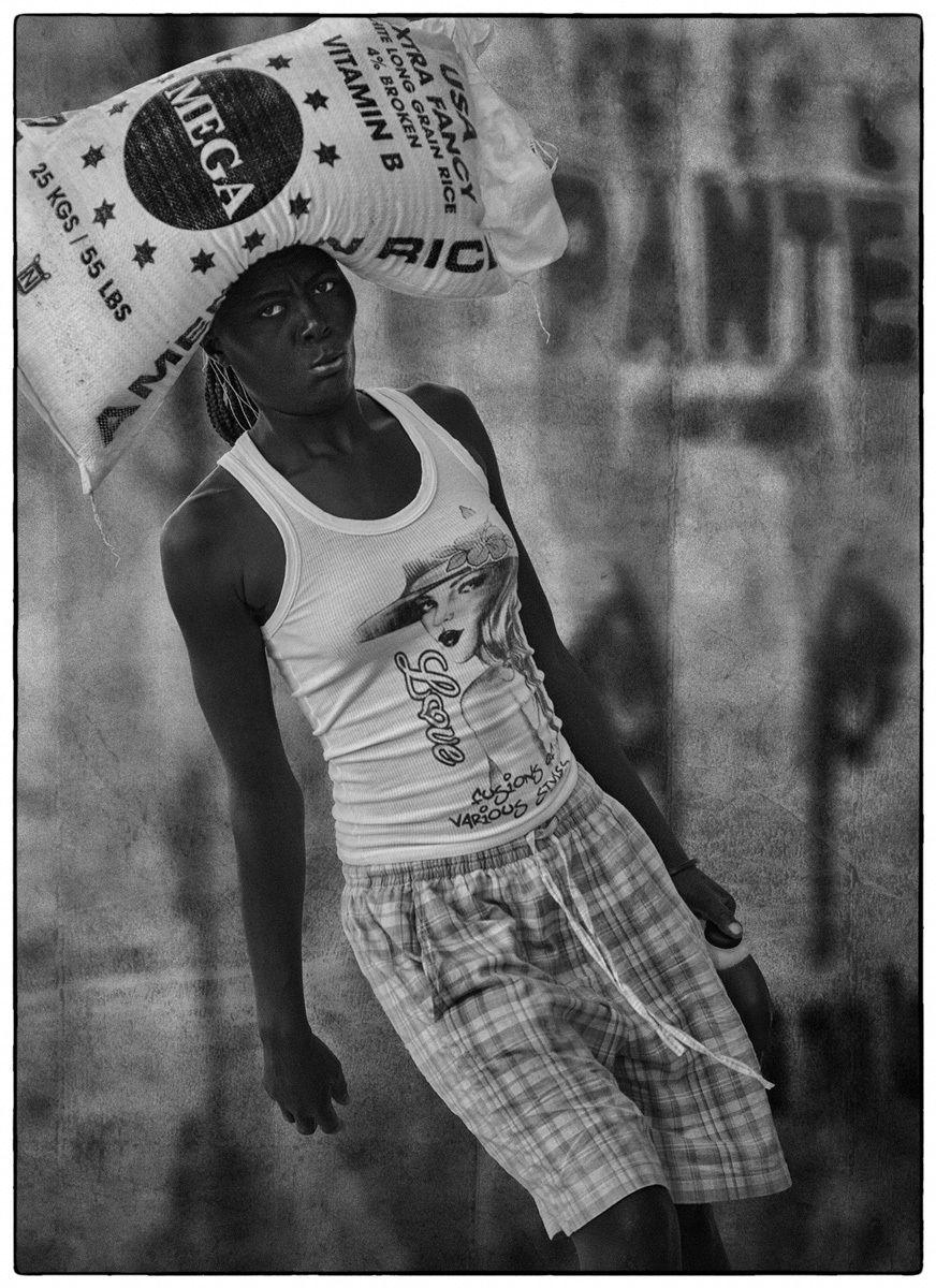 Haitian Woman Carrying Rice Bag