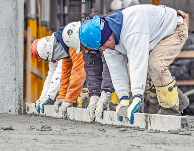 Workers Screed Freshly Poured Cement