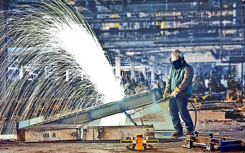 Using a Cutting Torch to Dismantle Old Facility