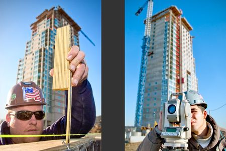 Construction workers take measurements at residential tower construction site