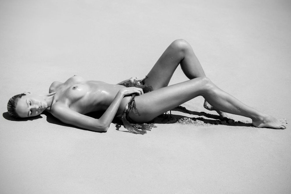 Girl Laying on Sand