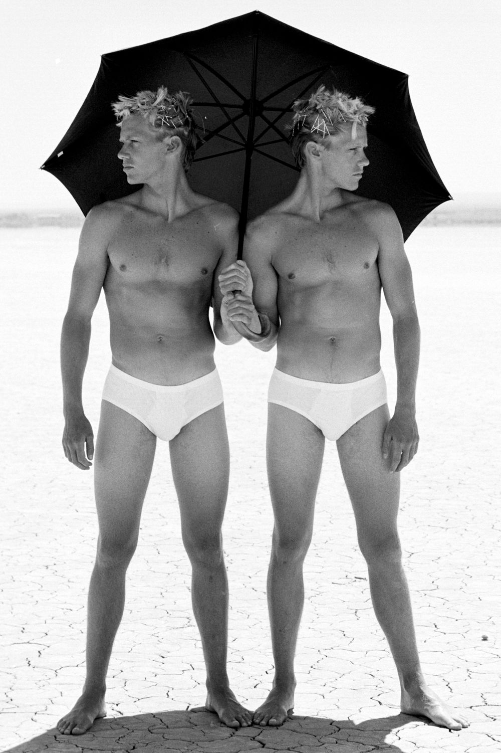 Brewer Twins in Desert with Umbrella