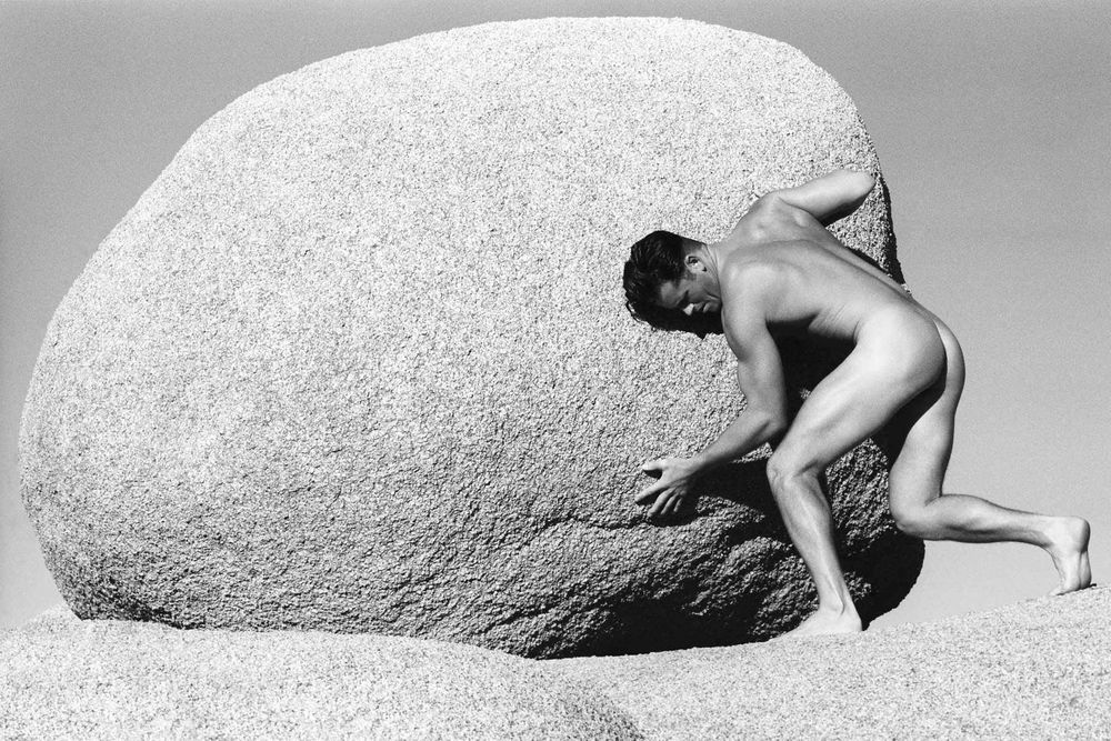 Fine Art Man Pushing Rock