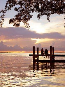 Couple on Dock at Sunset - Travel Photographer New York